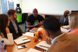 rsity of Michigan Ross School MBA students interview 2014 first-round NFL draft pick and Miami Dolphins offensive tackle Ja'Wuan James (center) at the team's training facility. Pictured from left are Alexa Likens, Jeffrey Gross, C.J. Azubuine, John Thompson, Aimee Grimshaw and Darryl Tricksey. Photo by Angel Valentin.