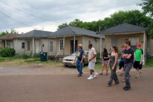 Sylvester Hoover of Delta Blues Legend Tours in Greenwood, MS, shows the group around the Baptist Town neighborhood, with its still-standing sharecropper shacks.