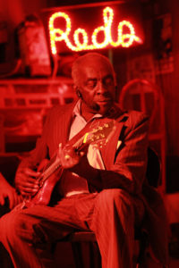 "Leo ""Bud"" Welch entertains at Red's Lounge, Clarksdale, MS. Students were treated to performances and often got to jam with well-known blues musicians along the roots tour."