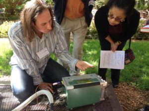 Jim LeMoine, research laboratory specialist associate, shows Addell Austin Anderson, director of the University of Michigan Detroit Center, carbon dioxide readings from the soil outside of the Michigan League. Leaders from the U-M Biological Station took faculty and staff outdoors to participate in an abbreviated experiment much like the ones students experience.